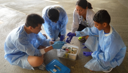 Young participants learn how to properly collect evidence from a mock crime scene.